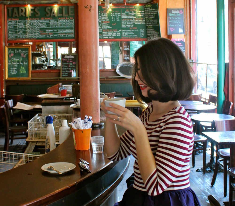 Lisa Czarina Michaud at a cafe in Paris