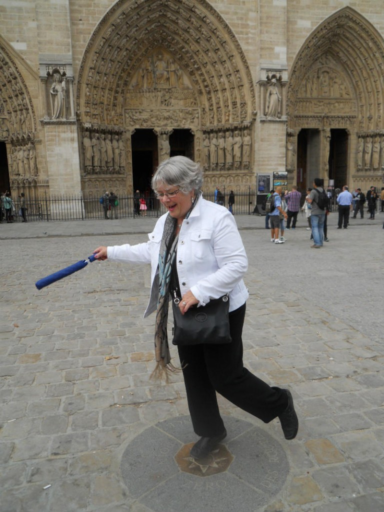 The author's mother is young at heart in front of Notre-Dame. Photo by Sarah Viehbeck