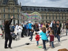 Bubbles in front of the Louvre by Kim Horton Levesque