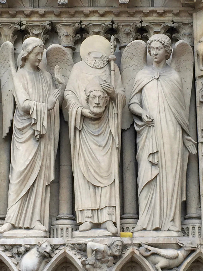 Statue of St Denis at Notre Dame cathedral/ Corey Frye