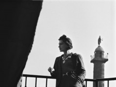 Coco Chanel on the balcony at the Ritz/ courtesy of Ritz Paris