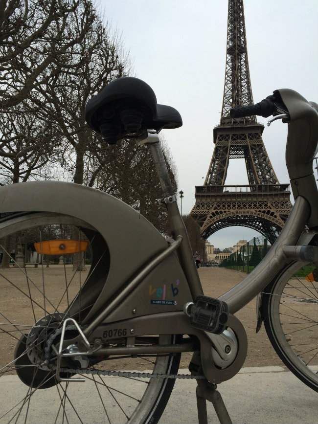 A velib in front of the Eiffel Tower