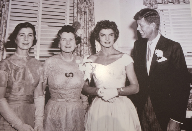 Jackie surrounded by John K. and Rose Fitzgerald Kennedy