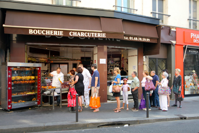The line for roast chicken on the rue des Martyrs