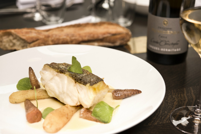 A dish of cod fish at Le Moulin de la Galette