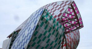 Fondation Louis Vuitton covered in Daniel Buren's L'Observatore de la lumière