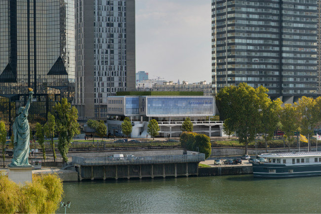 The new campus for Le Cordon Bleu, as seen from the Seine with Paris's statue of Liberty