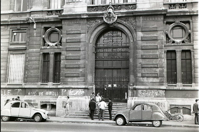"""""""Vive De Gaulle"""" is one of the graffiti on this Law School building. / Public Domain"""