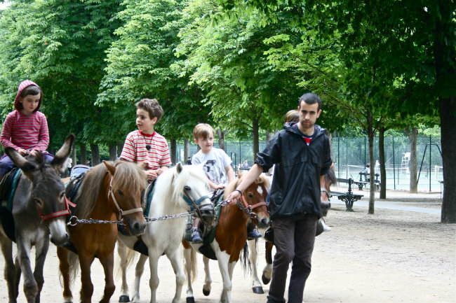 Riding ponies in the Luxembourg Gardens