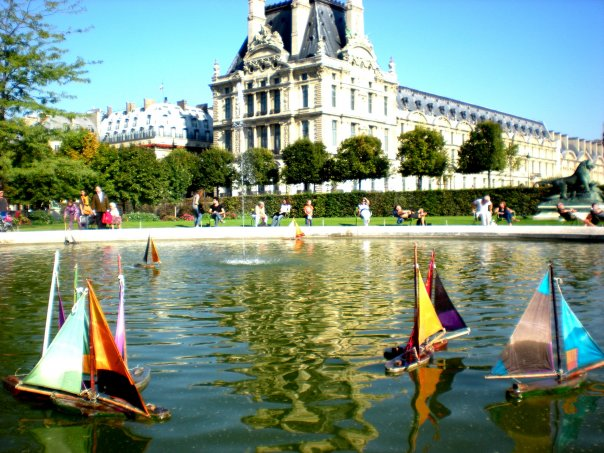 Toy boats on a pond in the Tuileries gardens