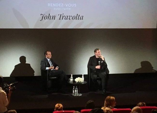 """""""That's what I do. I take risks,"""" John Travolta tells French audiences at Cannes"""