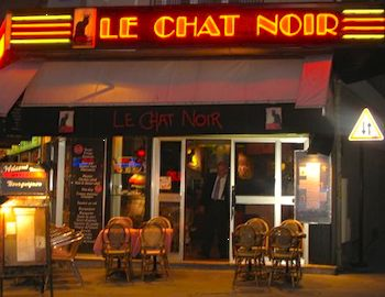 The sign on a hotel at the original location of Le Chat Noir
