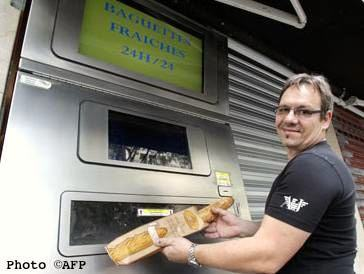 Jean-Louis Hecht & automated baguette machine. Photo credit: Metro-AFP.