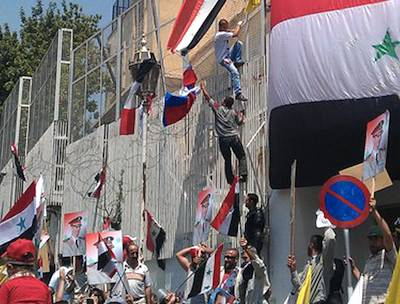 Aljazeera photo of French embassy in Syria under attack