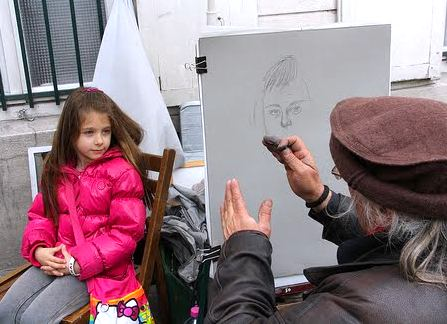 Montmartre portrait artist at work. Photo: Jeff Warder