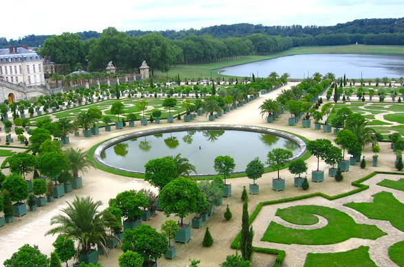 View over gardens from inside Versailles.