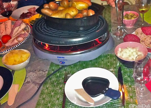 Raclette iron w/cured meats, vegetables, fruit and wine. Photo: ParisDali