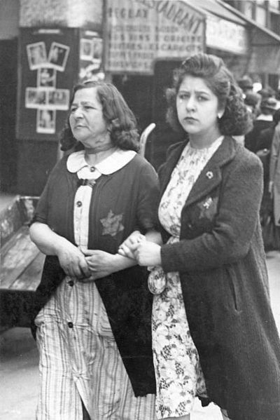 Jewish women in Paris wearing yellow stars.