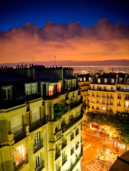 From Montmartre, one can watch the skies change over Paris. Photo by jorgealbarracin.