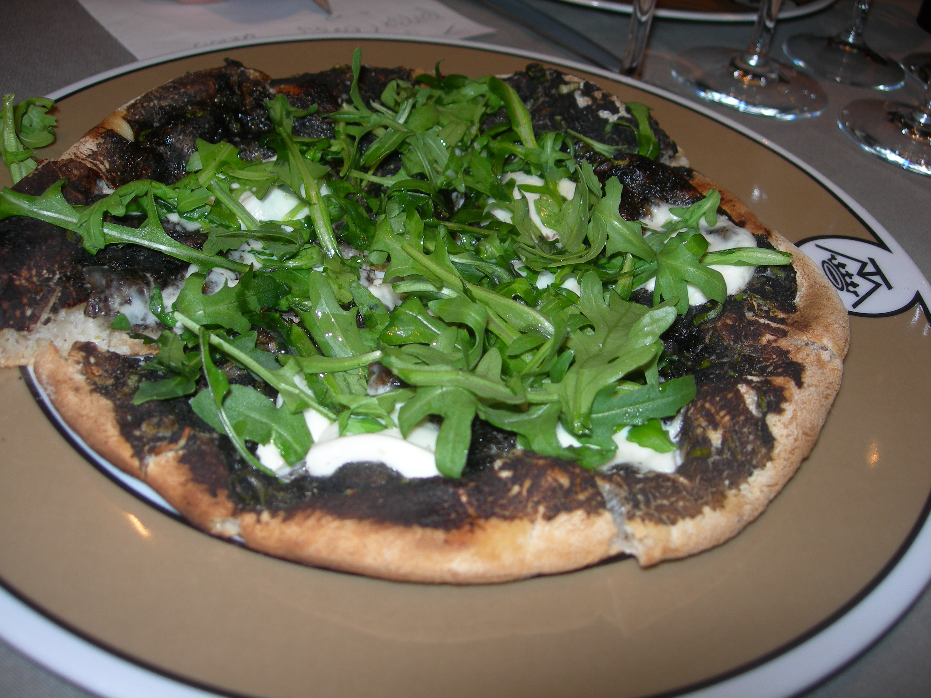Black truffle pizza from Maison de la Truffe, Paris