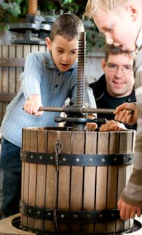Making cider with the cider press at Ferme de Gally. Publicity photo