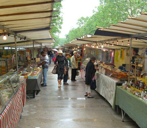 Rain or shine, Saxe-Breteuil market. Photo: Geoff & Ana-Maria